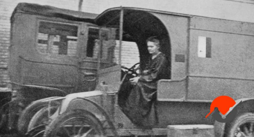 A image of Marie Curie in an mobile x-ray unit